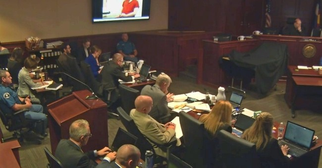 Defense starts questioning doctor in theater shooting trial