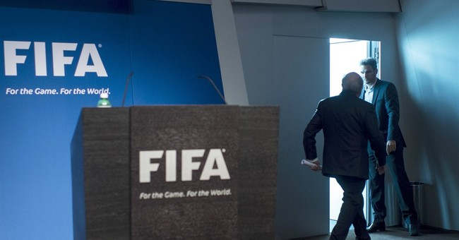 Disgraced FIFA president starts work on reforms amid crisis