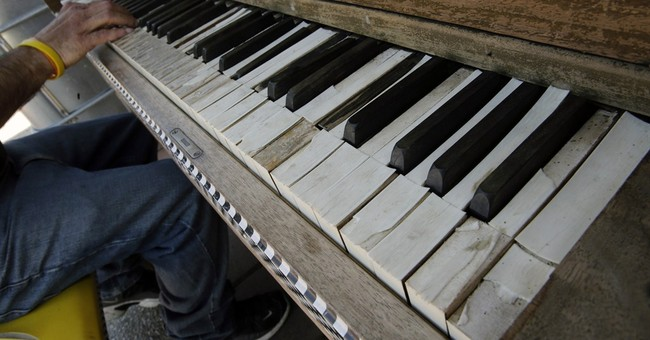 In struggling city, a piano brings calm, a player at a time