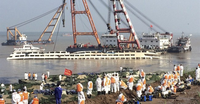AP PHOTO: 1st glimpse at China ship as it emerges from river