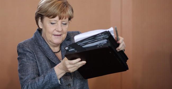Merkel urges G7 to throw weight behind climate fund