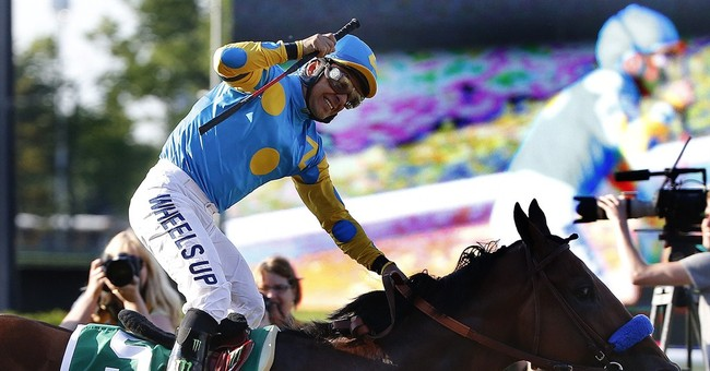 American Pharoah runs into history with Triple Crown