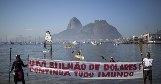 Brazil demonstrators decry state of Rio's Olympic waters