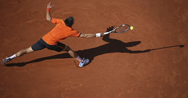Loss to Wawrinka in French final denies Djokovic career Slam