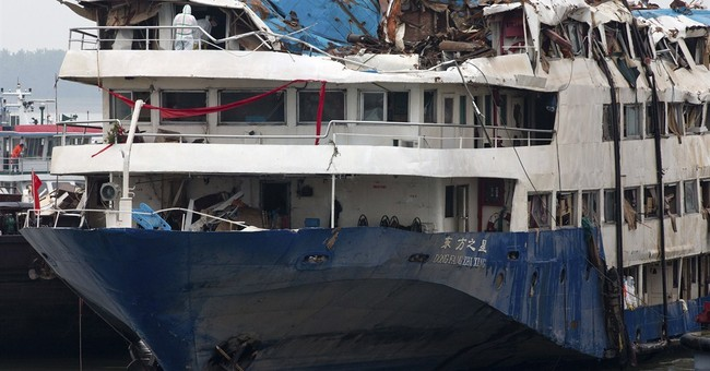 Relatives weep at morgue after China's Yangtze ship disaster