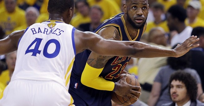 The Latest: Cavs even NBA Finals, beat Warriors 95-93 in OT