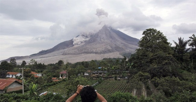 Indonesia volcano at high alert level unleashes fresh burst