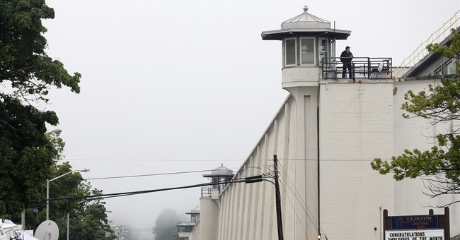 Police descend on small town in search for 2 escaped killers