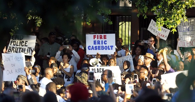 The Latest on pool incident: Protest rally draws hundreds