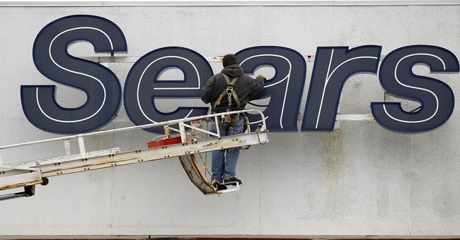 Sears 1Q loss narrows but sales slump continues