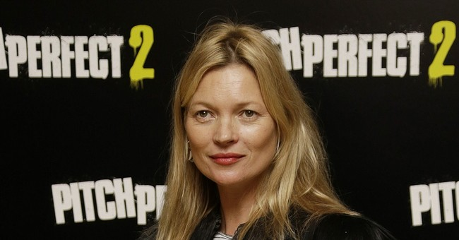 Kate Moss escorted off plane after being disruptive