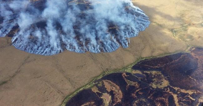 Alaska fire crews battling 2 large tundra wildfires