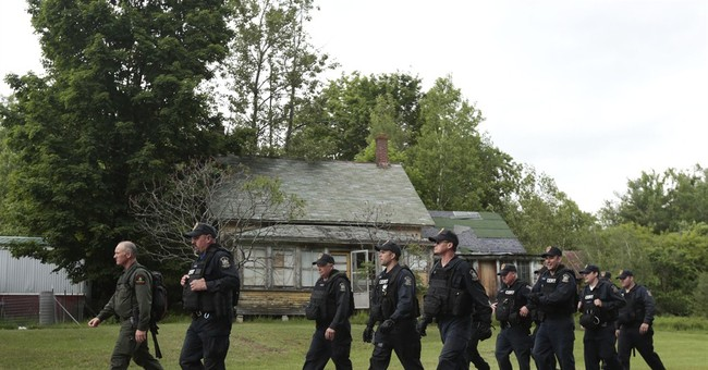 The Latest on prison escape: Police converge on town