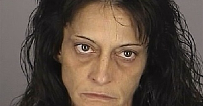 Police: Guard, 2 strippers smuggled booze, drugs into prison