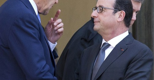 Kerry offers 'big hug' to Paris after attacks