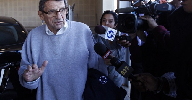 NCAA agrees to restore wins to Penn State, title to Paterno