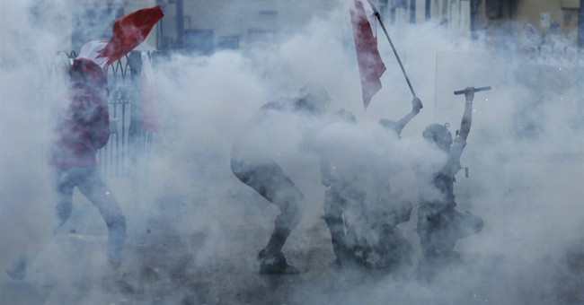 Bahrain Shiites march, clash with police over jailed leader