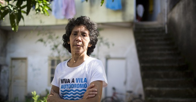 Holdouts: Slum resists eviction in shadow of Olympic Park