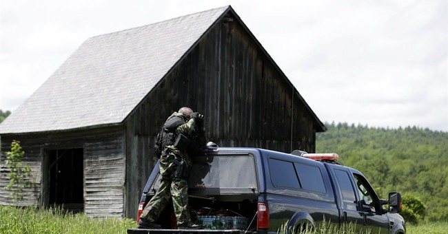 Hunt for killers expands to Vermont; staffer under suspicion