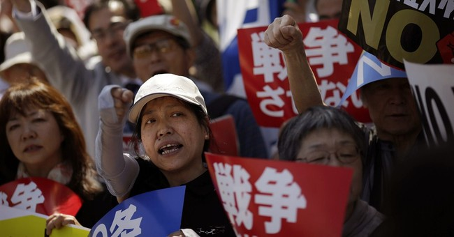 Constitutional questions grow over Japan PM's military plans