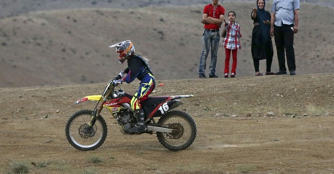 AP PHOTOS: In Iran, female motocross racer jumps barriers