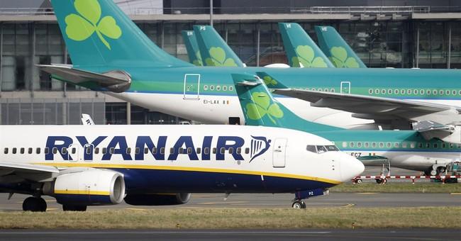 UK rules Ryanair must dump shares in Irish rival Aer Lingus