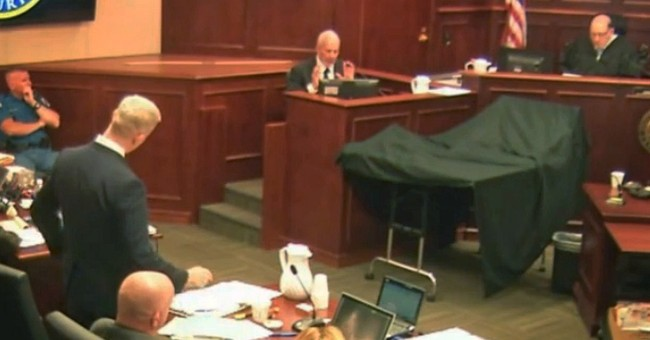 The Latest: Jury sees video of Colorado theater after attack