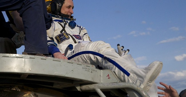 3 space station astronauts safely return to Earth