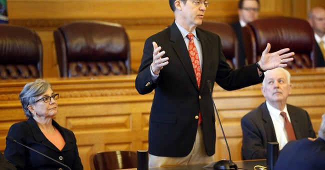 Kansas tax cutting model tarnished by sales tax increase