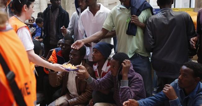 Milan appeals for help managing migrants