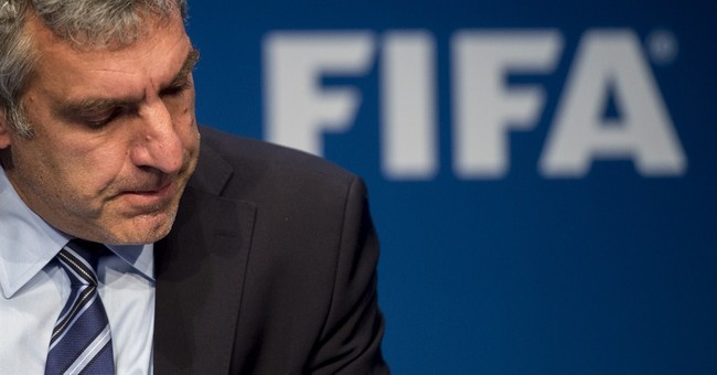 FIFA's top spokesman leaves job, Blatter urged to do same