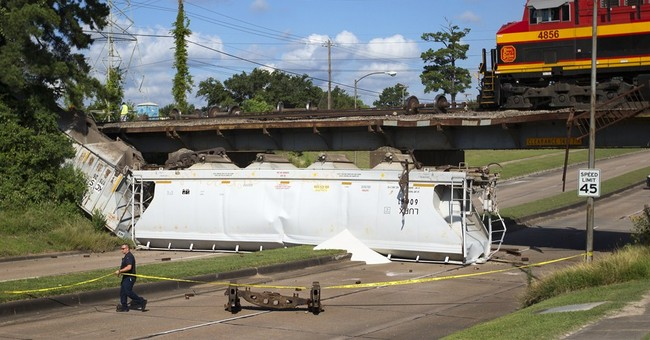 Derailed freight train falls from bridge onto Texas highway