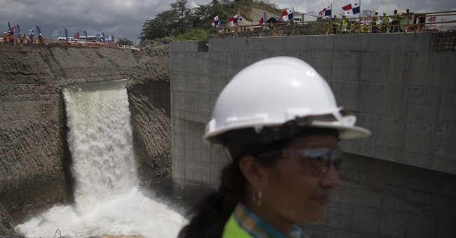 Workers begin filling Panama Canal's newly expanded locks
