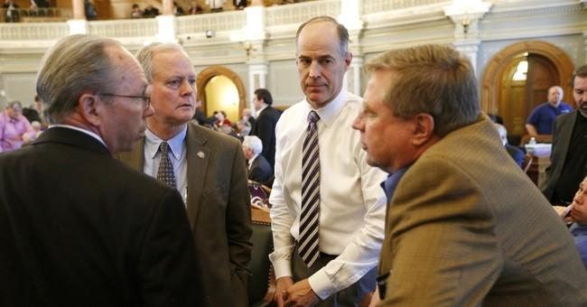 The latest: New Kansas tax plan drops ideas senators liked