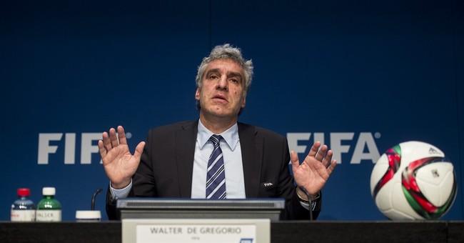 FIFA's top spokesman leaves job, Blatter urged to do same