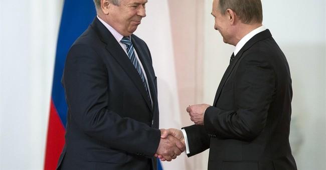 Putin praises Russia as open and democratic
