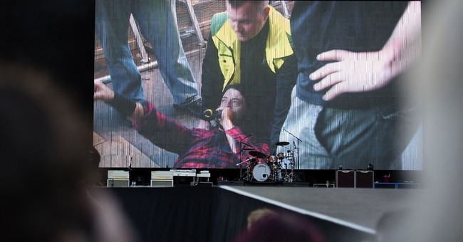 Foo Fighters cancel shows after singer injures leg on stage