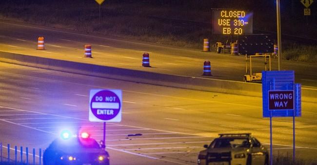 Suspect in brazen attack on Dallas police building killed