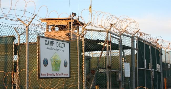 6 Gitmo detainees sent to Oman to break pause in transfers
