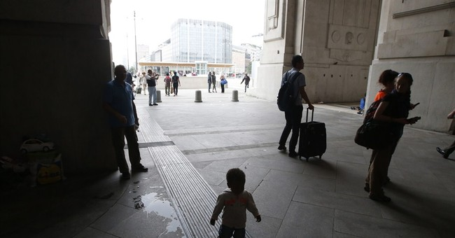 Milan officials close migrant reception area in rail station