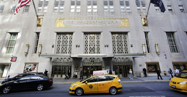 Police: 4 hurt when gun goes off at Waldorf Astoria