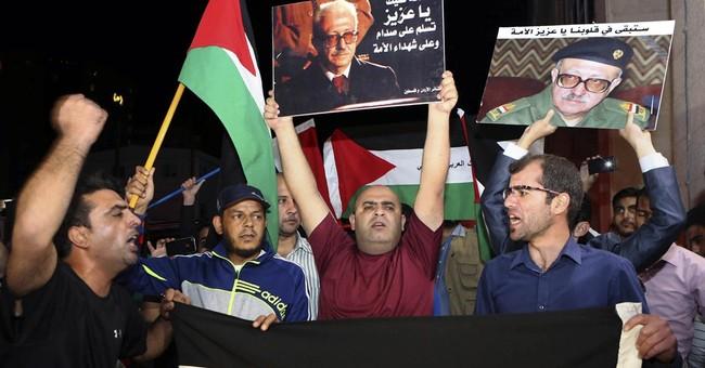 Body of Saddam deputy Tariq Aziz buried in Jordan