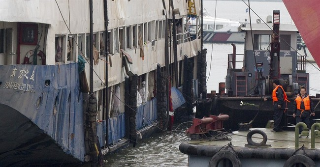 China revises boat sinking survivors to 12, down from 14