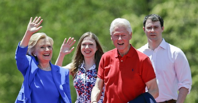 The Latest: Clinton urges house party guests to sign up
