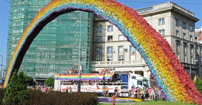 Thousands of gay rights supporters march through Warsaw