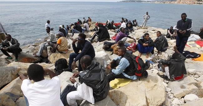 Italy warns EU over migrant redistribution proposal