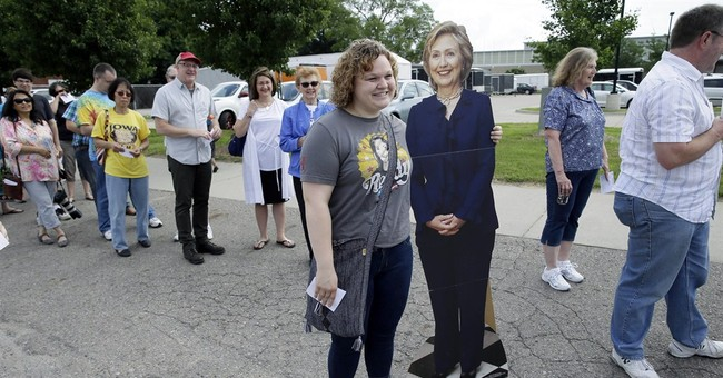 The Latest: Clinton: Obama must negotiate better trade deal
