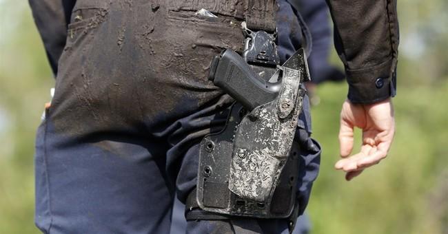 The Latest on prison escape: Manholes welded shut at prison