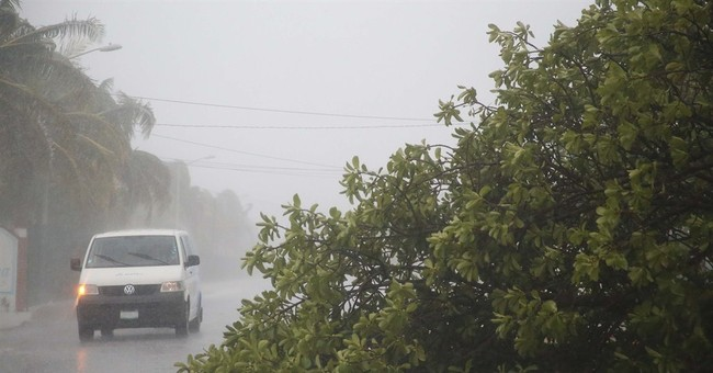 Tropical Storm Carlos hits at Acapulco with high winds, surf