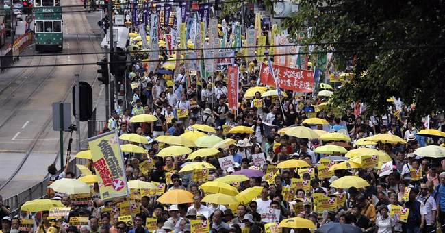 Thousands rally as Hong Kong braces for democracy showdown